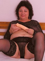 Mature chubby brunette ready for dildo insertion