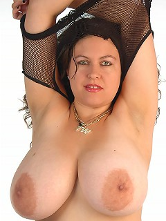 British babe Denise Davies playing and oils her huge hooters