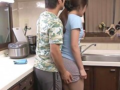 Asian Milf Has Her Skirt Lifted And Pussy Fucked In The Kitchen