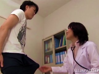 A Very Sexy Asian Nurse With Big Tits Playing With A Patient's Big Cock
