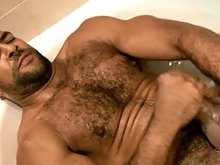 Muscle hairy stud Roman Wright takes a shower and masturbates