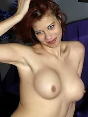 Experienced beauty spreads her swollen pussy lips