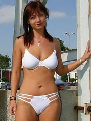 Slim mature candy gets naked in a public place