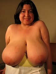 She is busting out of her top with massive breasts and cleavage for days