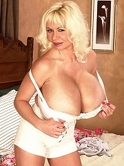 Luscious hotties with very big jugs pose exposed and diddle their slits.