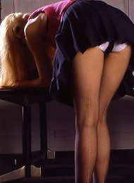 Blonde Girl In Stockings And Lingerie