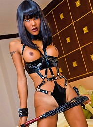 Hand-cuffed shemale-slave re...