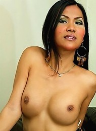 Asian ladyboy on couch gets ...