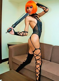 Fiery tranny mistress in lace up bodice and nylons