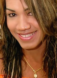 Huge hung ladyboy smiles as he cums all over himself