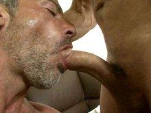 Bearded mature gay man sucks a cock